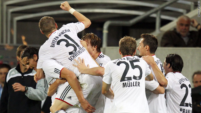 Bayern's delighted players celebrate Daniel van Buyten's injury time winner at Hoffenheim.