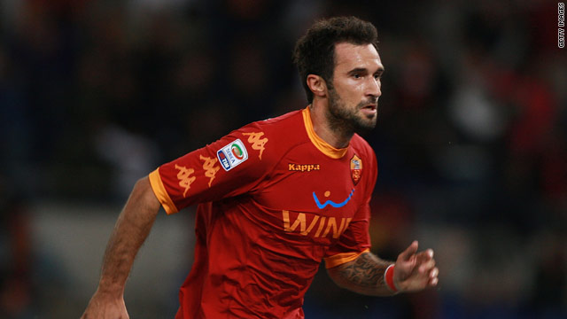 Mirko Vucinic celebrates his last-gasp goal in the Stadio Olimpico for Roma.