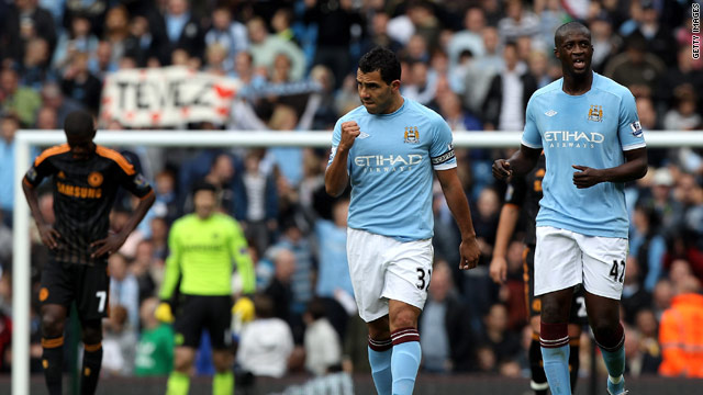 Carlos Tevez celebrates his superb goal at Eastlands to inflict the first defeat of the season on Chelsea.