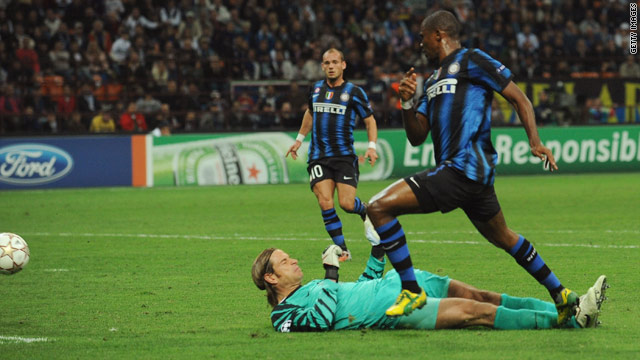 Samuel Eto'o nets the first of his three goals as holders Inter Milan proved too strong for Werder Bremen.