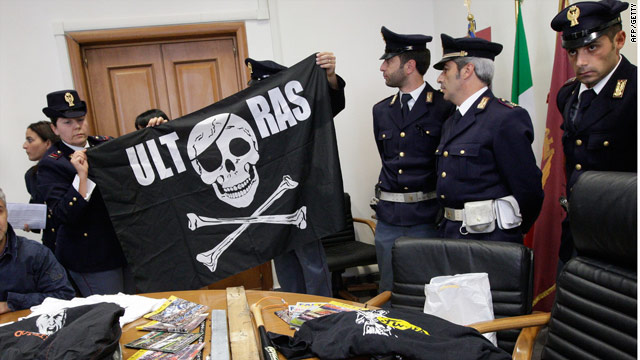 Naples police display banners and weapons seized after Liverpool players were attacked.