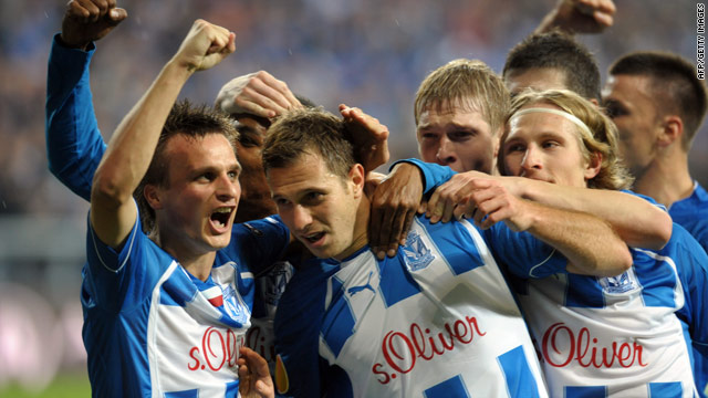 Poznan players celebrate their opening goal in their stunning 3-1 victory over Manchester City.