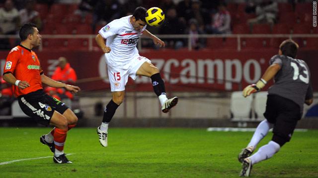 Alejandro Alfaro scores Sevilla's second goal against Valencia.
