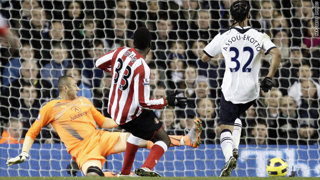 Asamoah Gyan slots home Sunderland's equalizer at Tottenham, his fourth goal in three starts since signing.