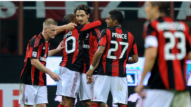 Milan stars celebrate a goal in the San Siro as they go top of Serie A.