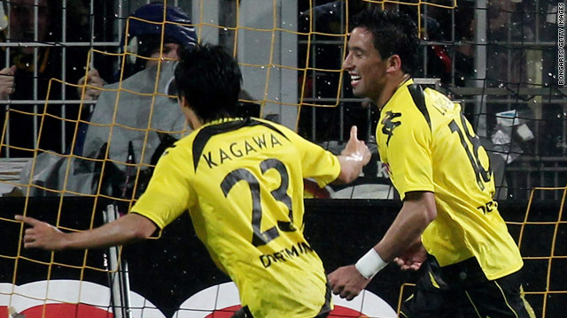 Goalscorers Shinji Kagawa, left, and Lucas Barrios celebrate after the latter doubles Dortmund's lead against Hamburg.