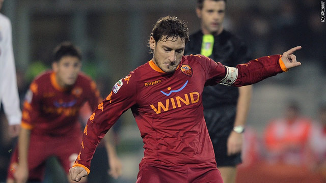 Francesco Totti levels from the spot for Roma in the Olympic Stadium.