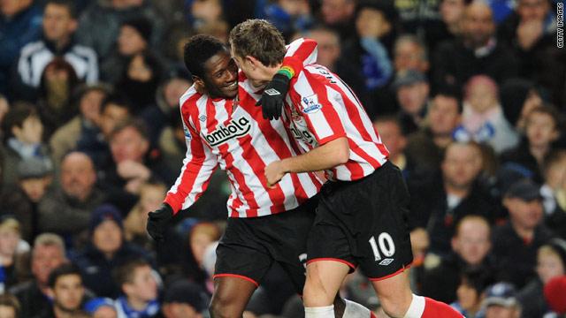 Asamoah Gyan and Jordan Henderson celebrate Sunderland's second at Stamford Bridge.