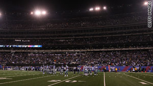 Power outages at New Jersey's New Meadowlands Stadium left fans in darkened conditions Sunday night.