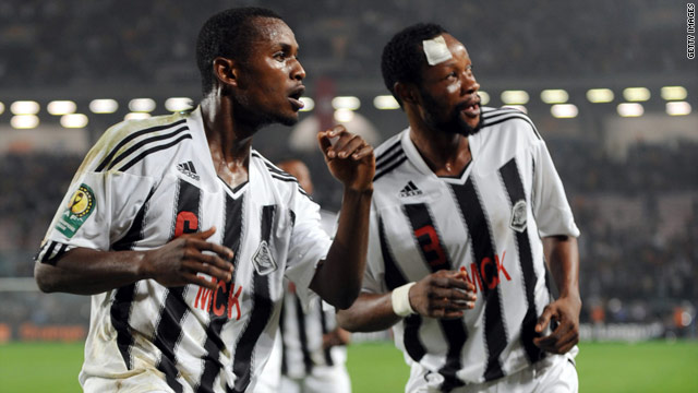 Mukok Kanda (left) celebrates after scoring the equalizer for TP Mazembe against Esperance on Saturday.