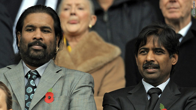 Indian brothers Balaji Rao (L) and Venkatesh Rao (R), Directors of Venky's, watch Blackburn's match with Chelsea.