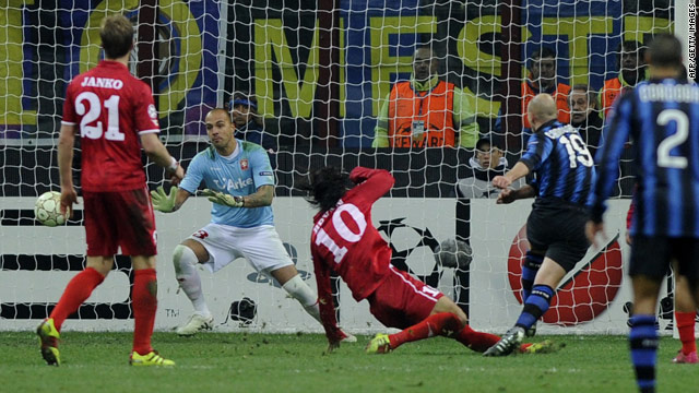 Esteban Cambiasso fires Inter Milan's winner in the Champions League clash with Dutch side Twente on Wednesday.
