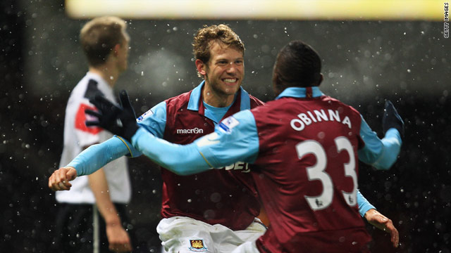 Jonathan Spector celebrates one of his two first half goals in the 4-0 win over Manchester United.