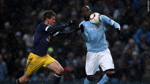 Mario Balotelli (right) proved a handful for the Salzburg defense with two goals at snowy Eastlands.
