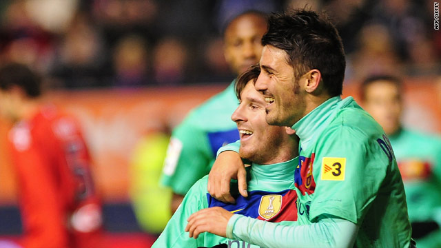 David Villa and goalscorer Lionel Messi (right) celebrate Barcelona's 3-0 win at Osasuna.