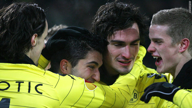 Dortmund's player surround Mats Hummels after his opening goal in the 2-0 win.