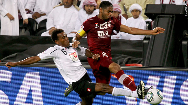 Hekari United midfielder Abraham Iniga, left, challenges Al-Wahda defender Haidar Alo Ali at the Club World Cup.