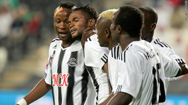 Mazembe players celebrate Mbenza Bedi's goal in their narrow victory over Pachuca.