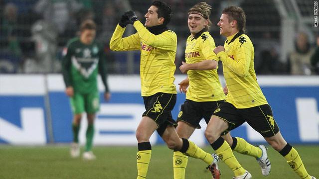 Nuri Sahin (L) celebrates Dortmund's first goal in a 2-0 victory over Werder Bremen.