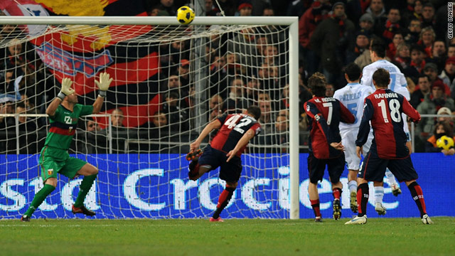 Napoli's Marek Hamsik scores the winning goal against Genoa in Saturday's Serie A match.