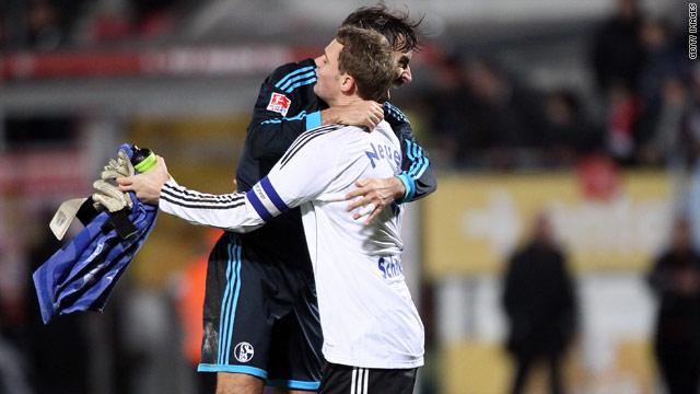 Schalke goalkeeper Manuel Neuer gets a hug from Spanish striker Raul Gonzalez after the 1-0 victory at Mainz.