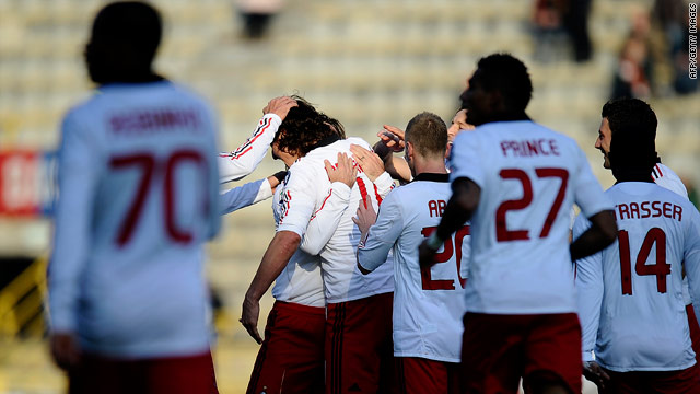Milan players celebrate Zlatan Ibrahimovic's goal in their convincing 3-0 victory at Bologna.
