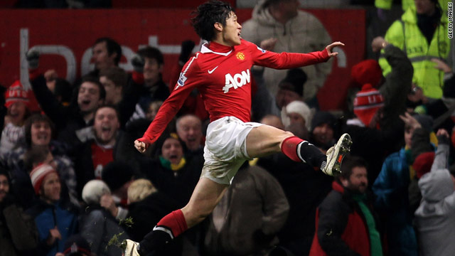 Ji-sung Park cannot hide his delight as his header puts Manchester United top of the Premier League table.