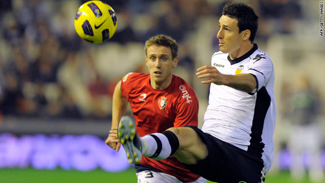Valencia forward Aritz Aduriz (right) was on target but Osasuna fought back to earn a 3-3 draw.
