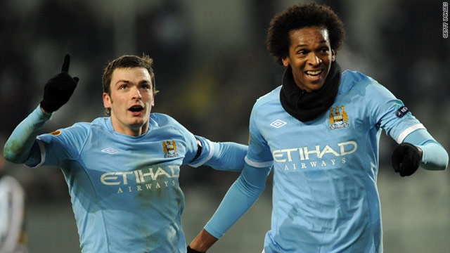 Manchester City's Jo (R) celebrates his goal against Juventus with its creator Adam Johnson.