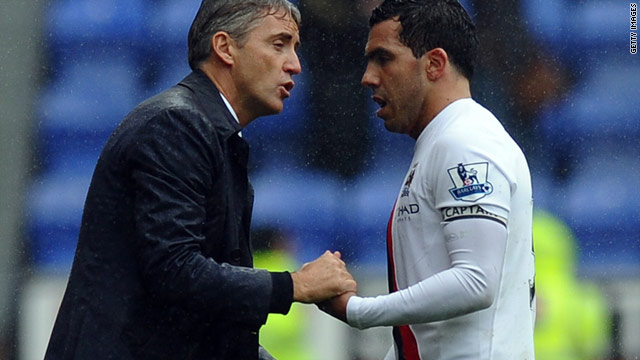 Roberto Mancini (left) is convinced skipper Carlos Tevez (right) does not really want to leave Manchester City.