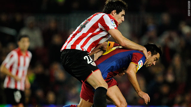 Barcelona midfielder Xavi cannot escape his marker as Bilbao came away from the Nou Camp with a battling 0-0 draw.