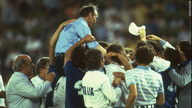 Enzo Bearzot is hoisted by players and officials alike after Italy's 1982 World Cup triumph.
