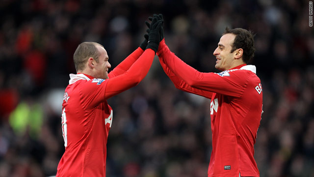 Wayne Rooney (left) congatulates Dimitar Berbatov after the Bulgarian's opener at Old Trafford.