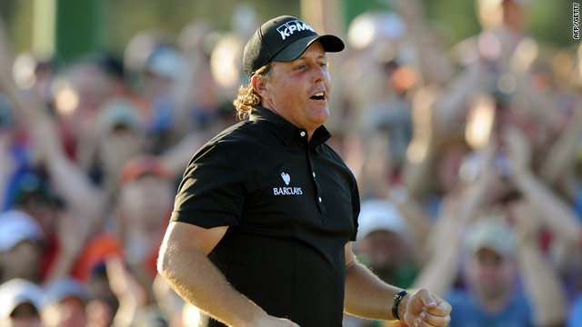 Mickelson celebrates his birdie putt on the 18th as he claims his third Masters title.