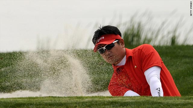 Third-round leader Y.E. Yang of Korea plays a bunker shot on his first hole in Suzhou on April 17.