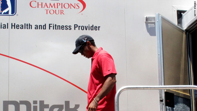 Woods leaves the PGA Tour's fitness trailer after pulling out of the Players tournament.