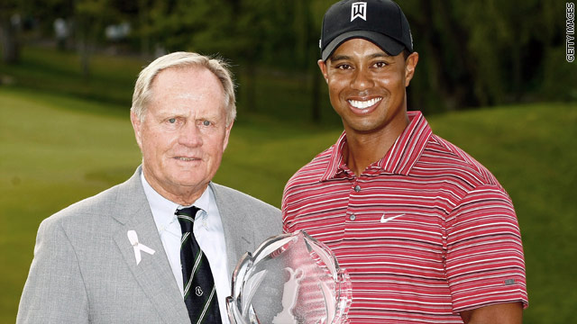 Woods with the Memorila tournament host Jack Nicklaus after winning last year's event