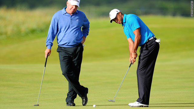Tiger Woods gets helps on the greens from his great friend Mark O'Meara.