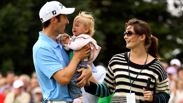 Ross Fisher celebrates with his wife and young daughter after winning the Irish Open in Killarney on Sunday.