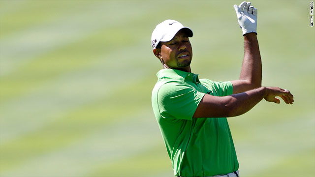 Tiger Woods dropped his club after playing his approach shot from the fairway on the 18th hole at Firestone.