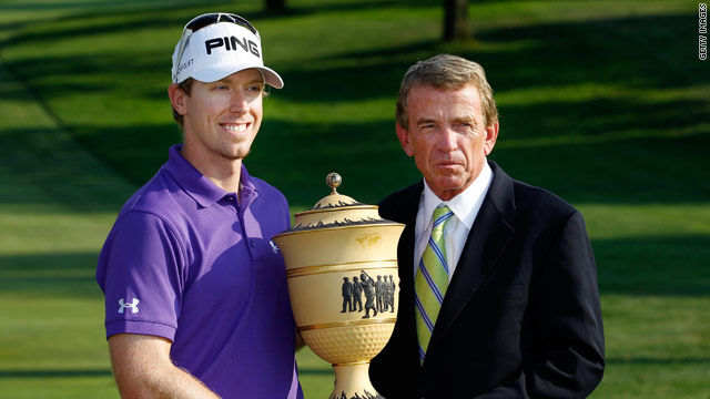 Hunter Mahan receives the winning trophy from PGA Tour commissoner Tim Finchem.