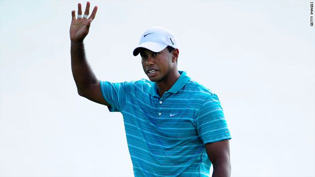Tiger Woods salutes the crowd after a successful birdie putt at the 17th hole at Whistling Straits on Saturday.