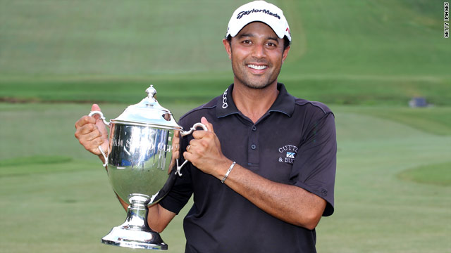 Arjun Atwal holds the Wyndham Championship aloft after becoming the first Indian player to win on the PGA Tour.