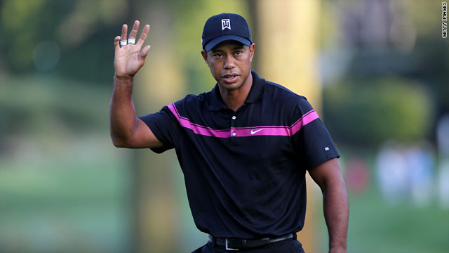 Woods celebrates one of his seven birdies during a fine opening round at The Barclays.