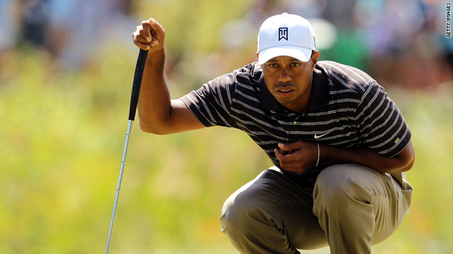 Woods lines up a birdie putt during his third round in Boston as he bids to retain his world number one status.