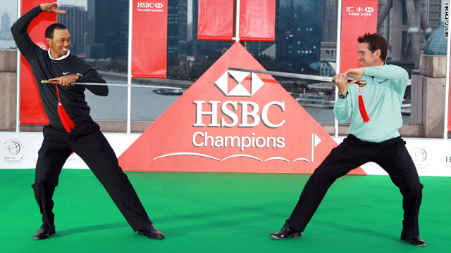 Tiger Woods, left, faces off against Lee Westwood at a promotional event for the HSBC Champions in China.