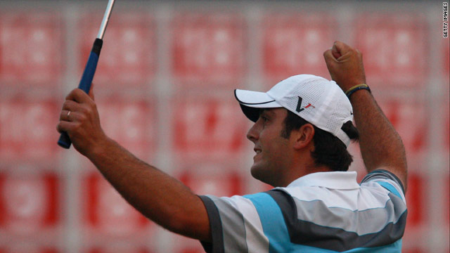 Francesco Molinari celebrates his superb victory after a dramatic head-to-head with Lee Westwood.