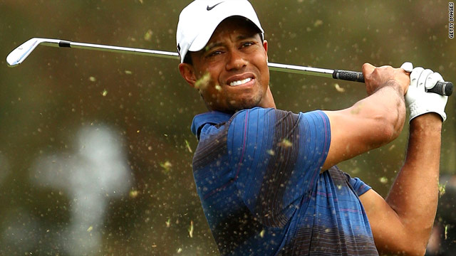 Tiger Woods hits out of the rough during his second round at the Australian Masters in Victoria on Friday.