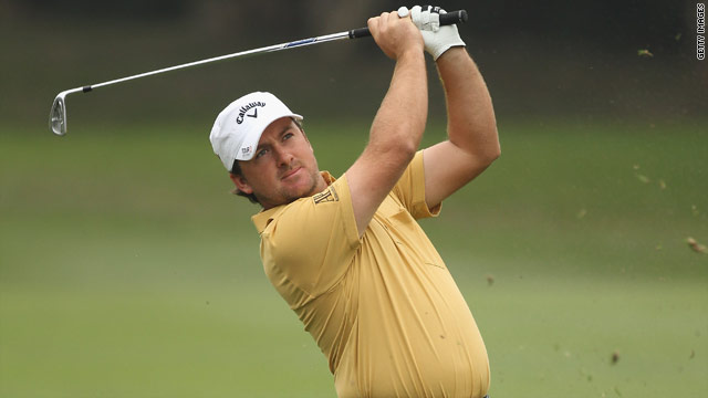 Graeme McDowell trails Hong Kong Open leader Mark Brown of New Zealand by three shots after the first round.