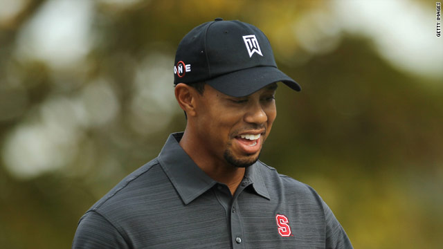 Tiger Woods is all smiles on his way to a six-under 66 to lead the Chevron World Challenge at halfway.